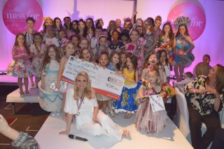 LMI Director Liz with the 50 finalists and charity cheque